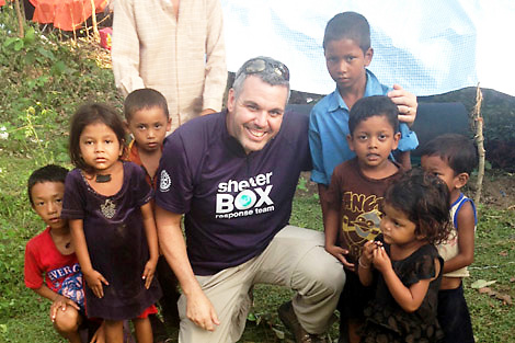 Ryan Lampasona with a displaced family affected by the recent flooding in Sindhupalchowk, Nepal (Ryan Lampasona/ShelterBox)