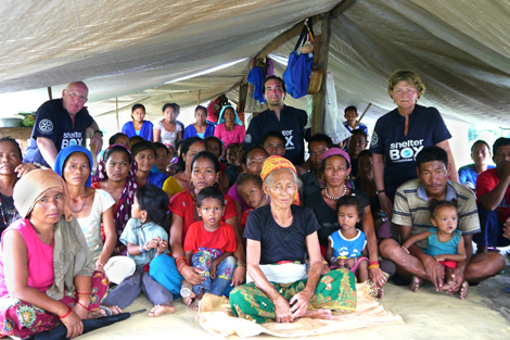 Response team members David Hatcher, Angelo Spencer Smith and Sallie Buck with villagers in Kunithari Village, Surkhet District, Central Nepal. Photo: ShelterBox.