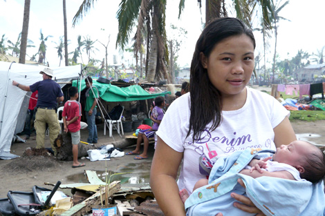 Christine Mae Ofiasa and her (then) fourteen-day old baby, Rona Mae, were among some of the early recipients of a ShelterBox aid after Haiyan first struck, Bantayan, Philippines, December 2013.