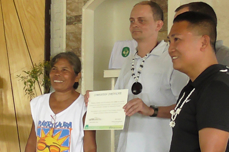 Philippines country coordinator, Toby Ash (pictured center) in the Philippines