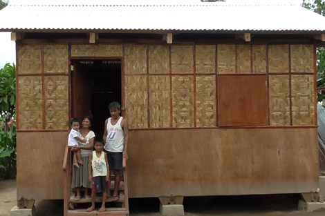 Families move into their new homes in the Philippines Photo: Toby Ash/ShelterBox.