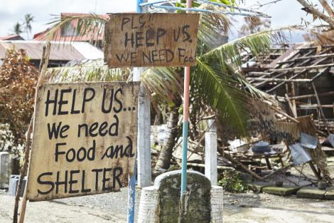 Messages of help line the roads in Eastern Samar in the Philippines where Typhoon Hagupit first made landfall. Image courtesy of Liam Norris.
