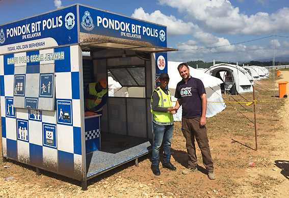 Australian ShelterBox Response Team (SRT) member, Andrew Clouting with Malaysian police at the ShelterBox camp
