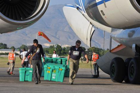 Dave Eby and Wayne Robinson were among the first to collect the ShelterBoxes as they arrive at Port au Prince airport.