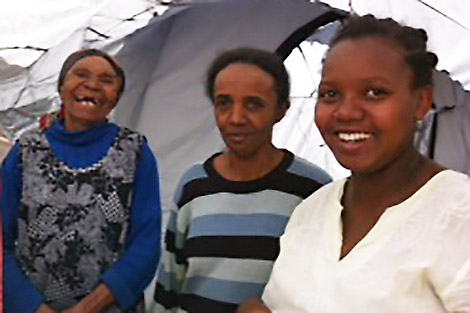 Image of Ernestine Lravaomalala (centre), a recipient of a ShelterBox tent, with her mother and her daughter.