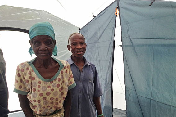 ShelterBox beneficiary Alice, takes a first look around her ShelterBox tent. (Becky Maynard/ShelterBox)