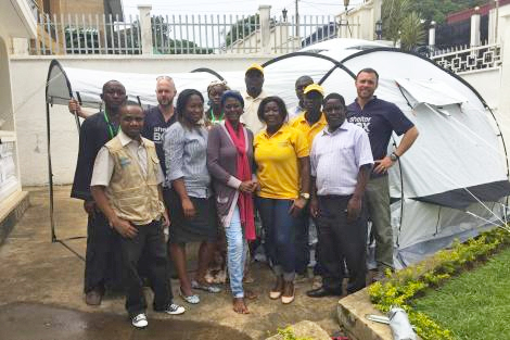 Image of ShelterBox response team members Todd Finklestone (US) and Ryan Schaafsma (US), along with staff at aid agency IEDA Relief in Cameroon.