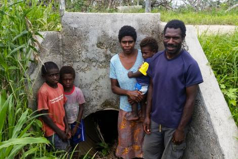 ShelterBox beneficiary Kalib William and her family next to the storm drain pipe they hid in while Cyclone Pam hit the island of Tanna in Vanuatu. (Jimmy Griffiths/ShelterBox)