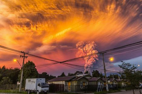 Dramatic image of volcanic ash cloud in evening sky.