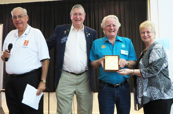 Greville Easte receives his Award for Outstanding Service to ShelterBox from Past RI Director and ShelterBox Australia colleague, John Lawrence