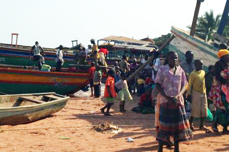 Refugees who have left Burundi due to political conflict travel by boat to Port Kiblizi in neighbouring Tanzania. (Todd Finklestone/ShelterBox)