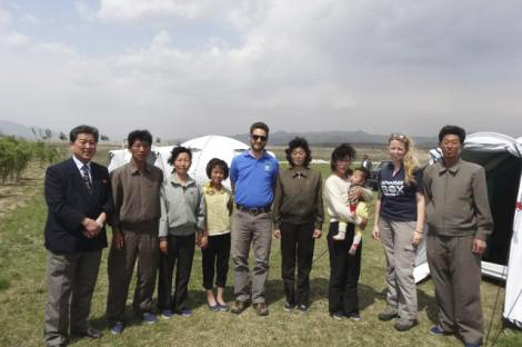 ShelterBox response team members Alice Jefferson and Sam Hewett (both from the UK) with recipients of ShelterBox aid in the Democratic People's Republic of Korea.