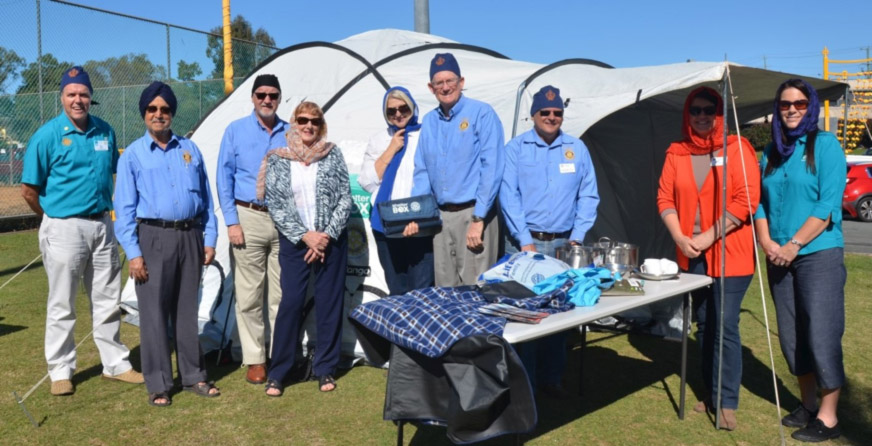 Rotarians & partners from Logan & Beenleigh setup a Shelterbox tent and display at the Temple. Note the headwear expected to be worn while visiting.