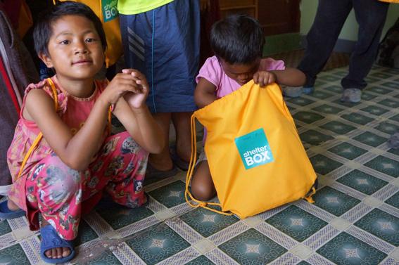 Children at an orphanage in the Kathmandu Valley receive ShelterBox school supplies (Torstein Neilsen/ShelterBox)