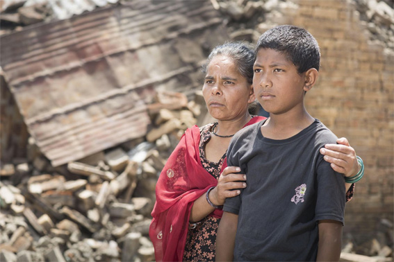 Raju and his mother Nirmala stand in front of the ruins of their family home. (Emily Whitfield-Wicks/ShelterBox)