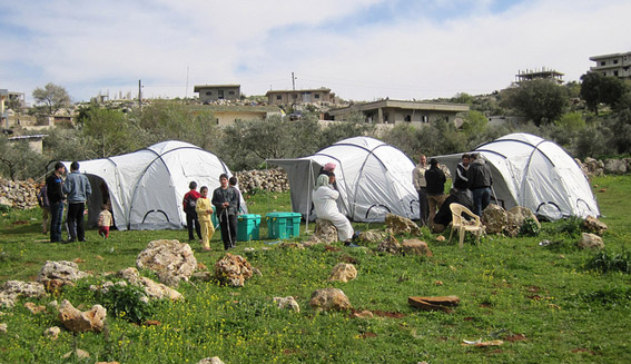 Shelterbox tents and Syrian refugees outside a village in Lebanon