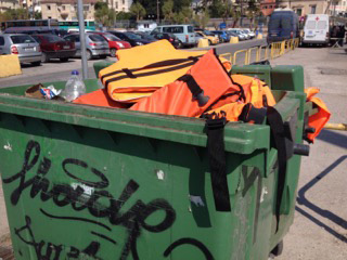 Disgarded lifejackets in a bin on the island of Lesbos