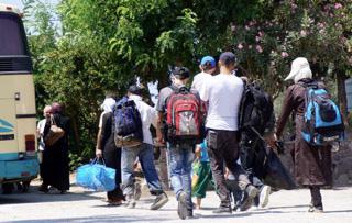 More than 107,000 migrants arrived on Lesbos ls June, more than the previous 12 months put together