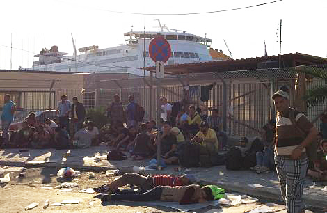 Refugees waiting in the harbour area of the island capital, Mytinini.