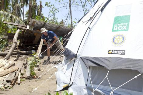 Response Team volunteer Harry Roberts with a ShelterBox relief tent in San Roca, Albay, Philippines August 2014.