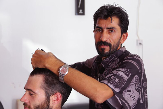 image of Nizar, cutting a man's hair
