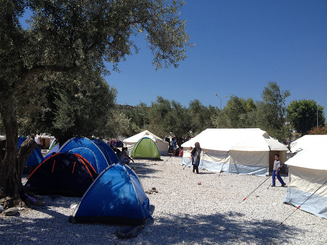 Image of UN spec tents as supplied by ShelterBox and small camping tents brought by refugees