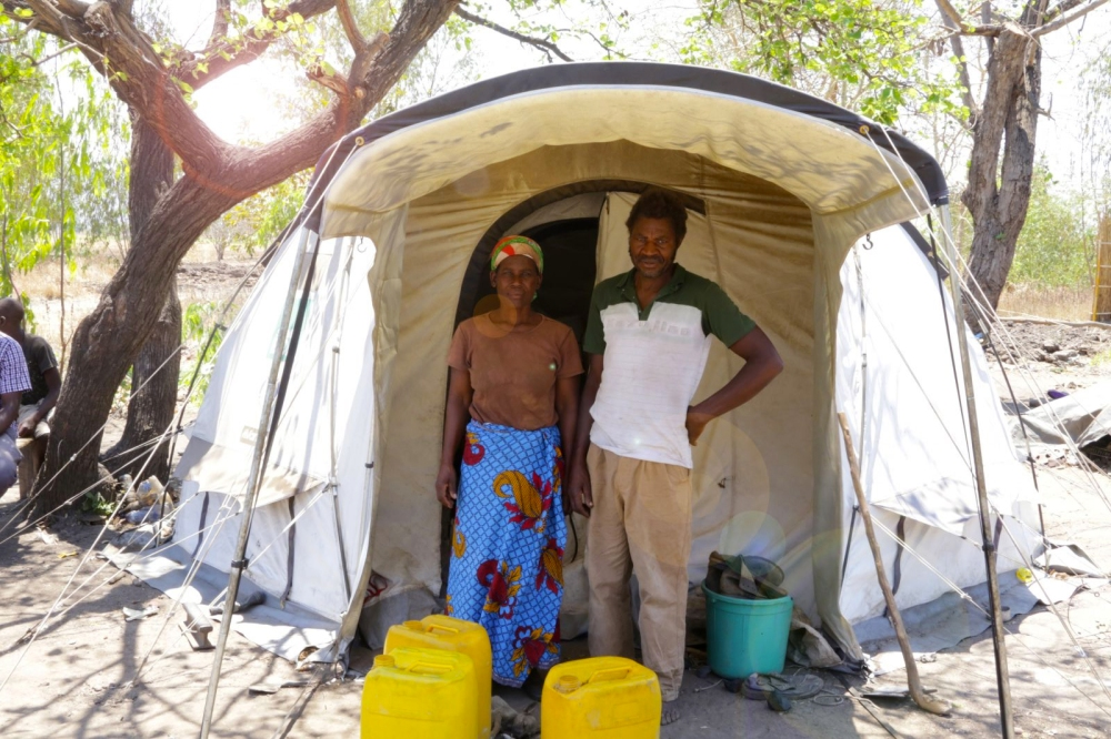 William and Annie Namakoka in front of their ShelterBox tent in Zomba, Malawi