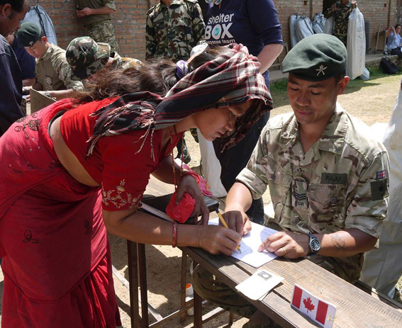 Soldiers form the Royal Gurkha Rifles help to distribute ShelterBox aid in Phataksila, Nepal.