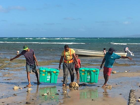 ShelterBoxes coming ashore on Makogai Island