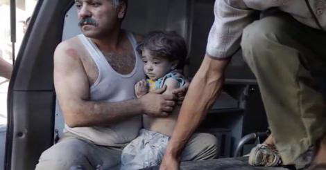 Father and child in a makeshift ambulance in Kamounia