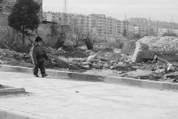 Aleppo - child with destroyed cityscape background