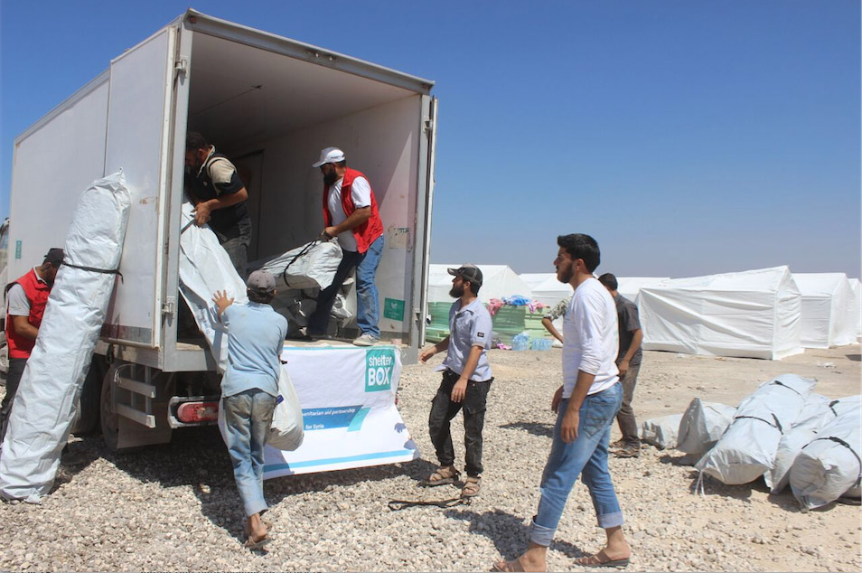 Hand In Hand for Syria volunteers unload ShelterBox aid in Idlib