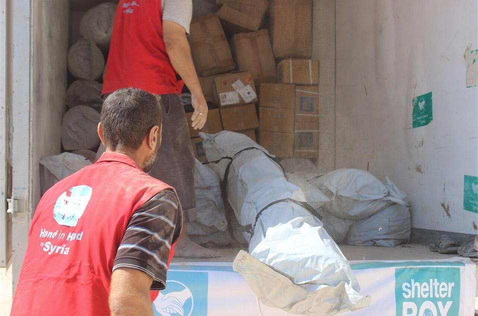 HIHS volunteers unload a truck