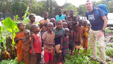 ShelterBox response team volunteer Martin Strutton helping families fleeing violence from Burundi to Tanzania – a joint ShelterBox IOM deployment in 2015