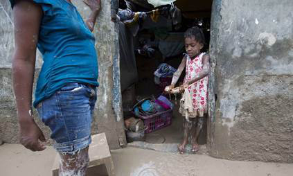 Little girl in doorway of flooded house