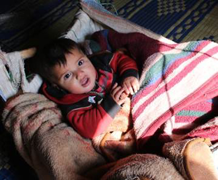 Syrian baby wrapped in blankets