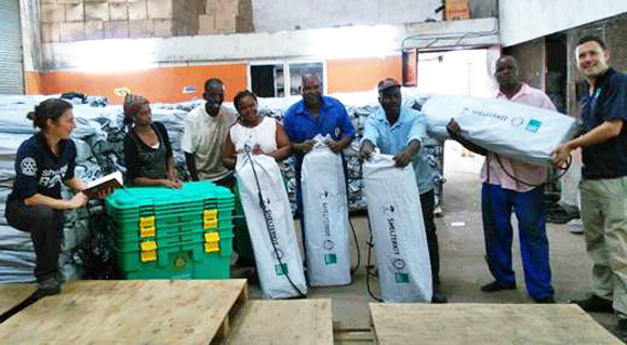 Image of shelterkits being loaded in a warehouse in Mozambique