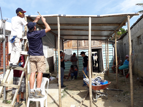 A ShelterBox Response Team member helps construct a shelter