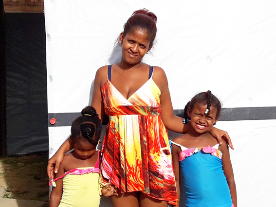 Yanira, aged 23, and their two daughters, aged five and seven