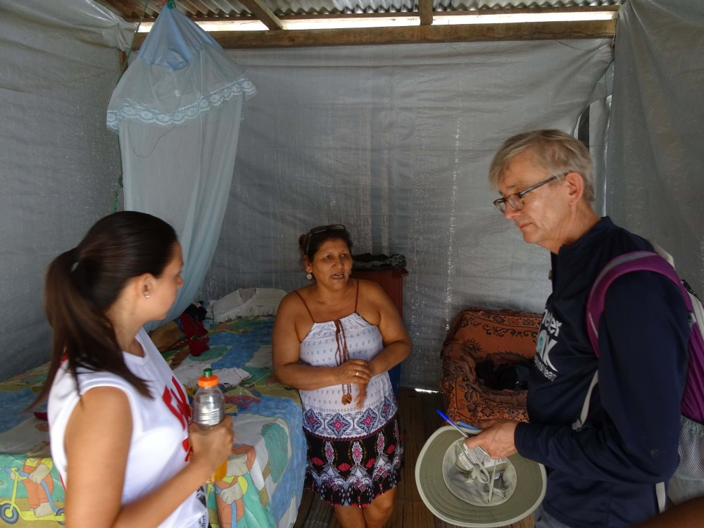 Photo of James Sinclair Taylor meeting earthquake survivors in Ecuador.